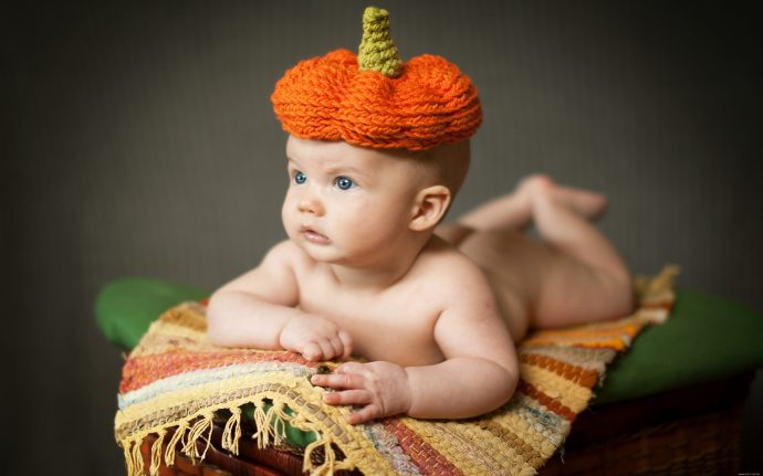 new_born_baby_with_orange_hat-wide